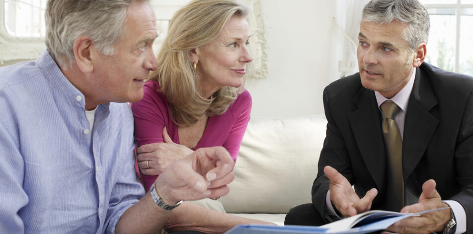 couple with an attorney for estate planning