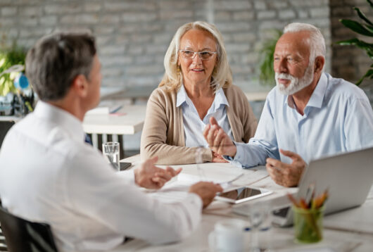 man and woman estate planning with their attorney